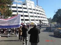 A procession rally with placards accompanied by the Band Party from Shillong Club
