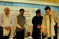 Shri P.R.Gharphalia, Commissioner for Persons with Disabilities, Govt. of Assam lighting the lamp during the inaugural programme